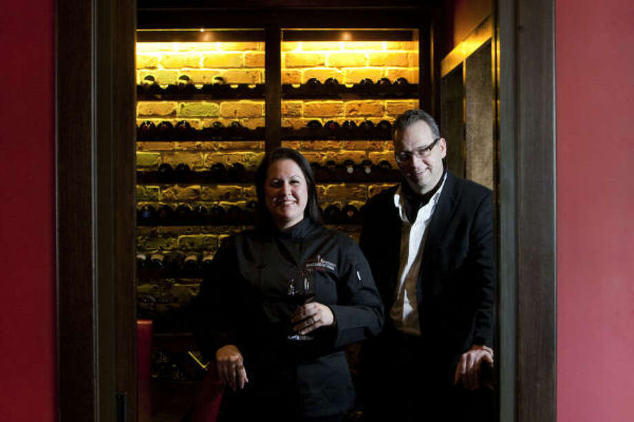 Gina Percovich, manager and executive pastry chef, and her husband, Gianfranco, are  co-owners Tango & Malbec Restaurant and Lounge in the Galleria area. Photo: Johnny Hanson, Houston Chronicle
