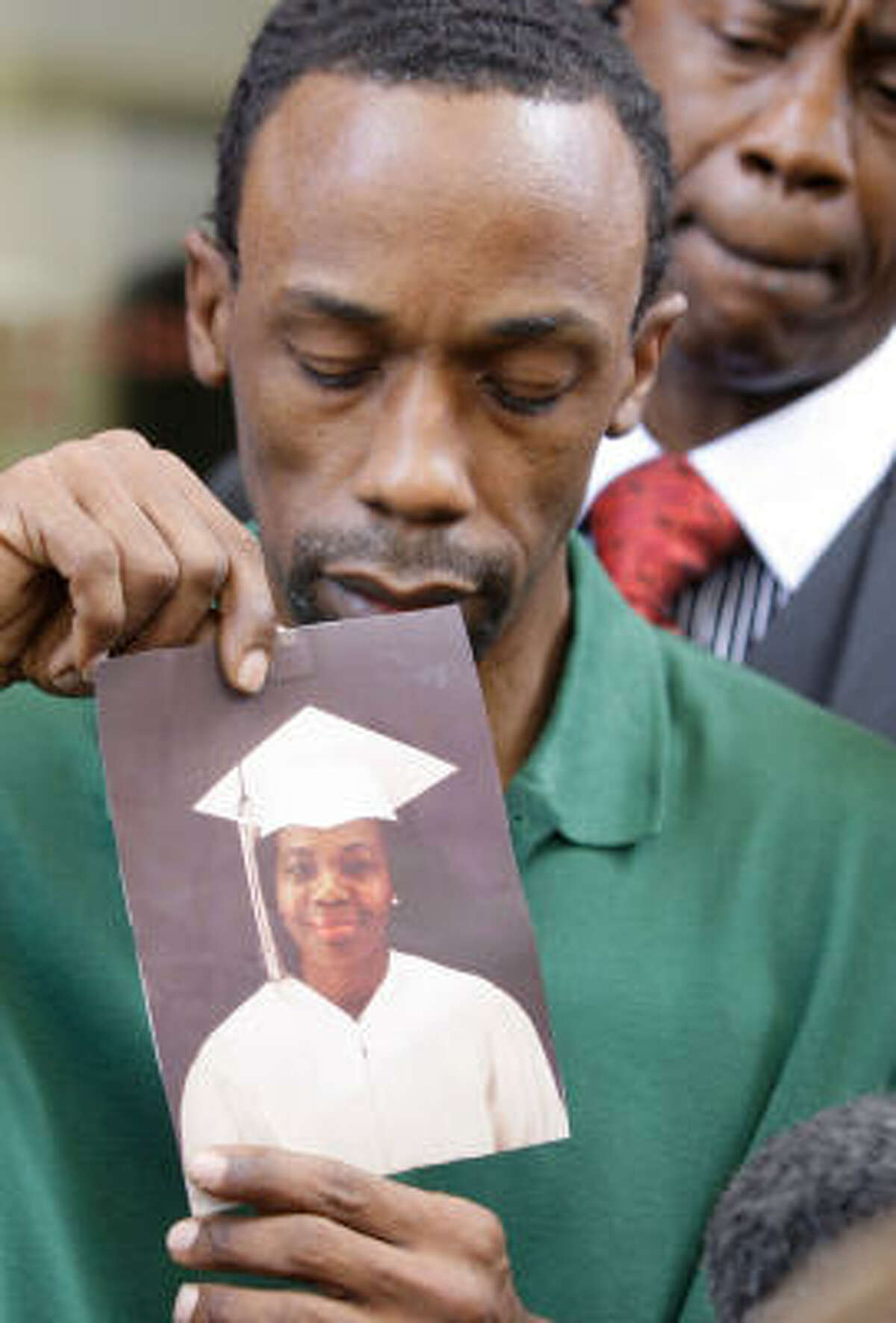 Michael Anthony Green holds a photo earlier this year of his mother, Mary Ann Strait, who died while he was in prison.