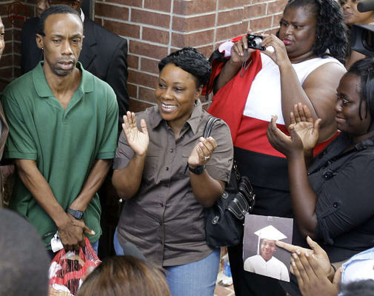 Michael Anthony Green, left, who was wrongfully convicted for rape, is released to the joy of his aunt Brenda Murray, center, earlier this year outside the Inmate Processing Center building in Houston.