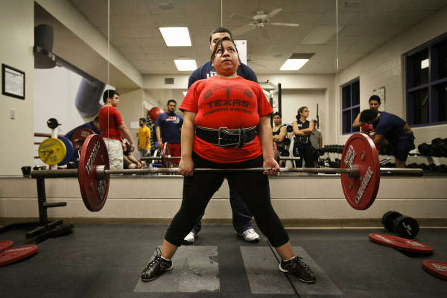 Olga Hernandez, one of two women on the University of Houston-Downtown's powerlifting team, practices the deadlift. The group has won the World Association of Benchers and Deadlifters collegiate team championship for three years. Photo: Todd Spoth, For The Chronicle