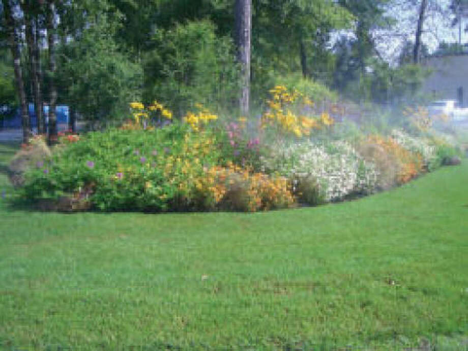 deep down sprinkler systems maintain good subsoil moisture for plants - Toms Lawn And Garden
