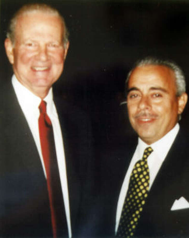 Vincent Carnaby, 52, is seen with former Secretary of State James Baker. Carnaby of Pearland held himself out as a federal intelligence agent but was sometimes reluctant to talk about his precise job and employer. At times he mentioned the Central Intelligence Agency or the Department of Homeland Security. He was the president of the local chapter of the Association for Intelligence Officers. Photo: Courtesy Photo