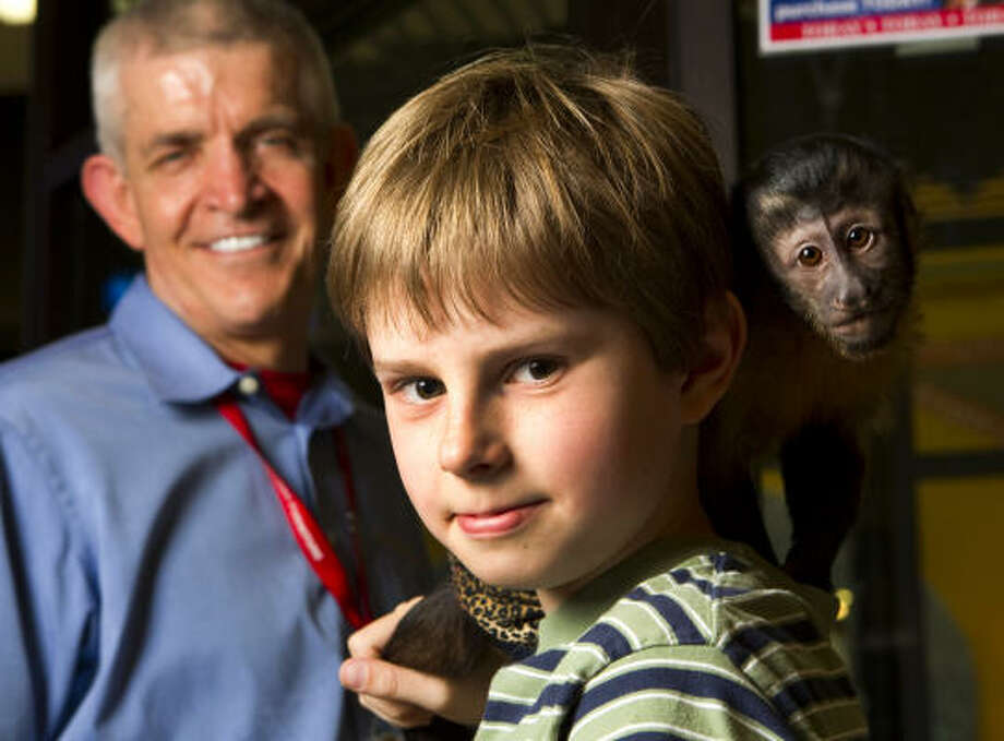 "Logan Burnaman, now 12, gave his savings of $200.96 to Jim ""Mattress Mack"" McIngvale after the Gallery Furniture fire last year. McIngvale named this monkey after him. Photo: Brett Coomer, Chronicle"