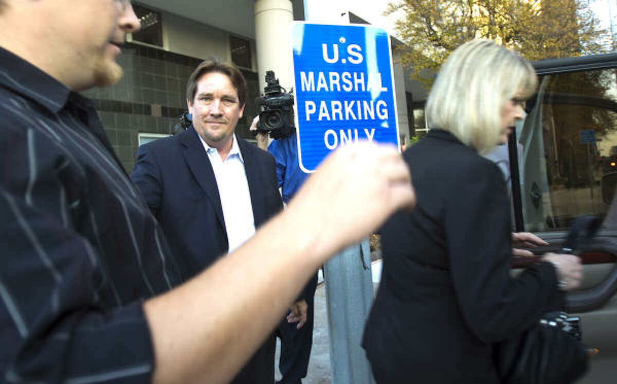 Developer Michael Surface, shown leaving the federal courthouse Tuesday, pleaded not guilty to conspiracy and bribery in the case against County Commissioner Jerry Eversole.
