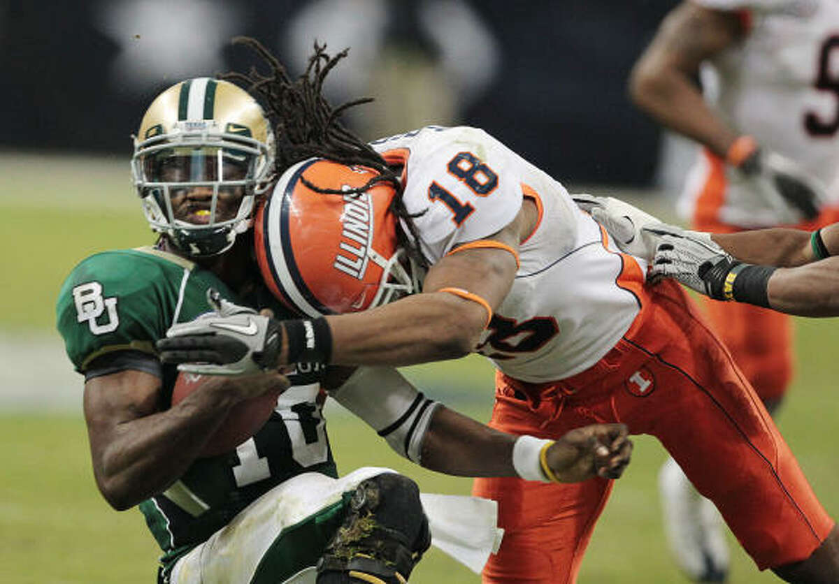 Baylor quarterback Robert Griffin III absorbs a hard hit by Illinois linebacker Nate Busey in a disappointing loss.