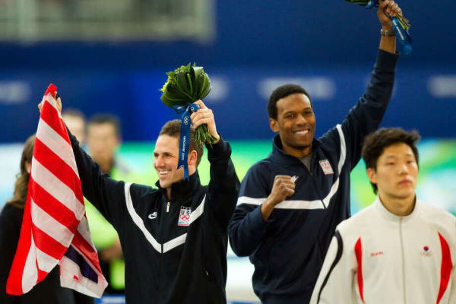 Chad Hedrick, left, and Shani Davis, center, celebrate their medals. Photo: Smiley N. Pool, Chronicle Olympic Bureau