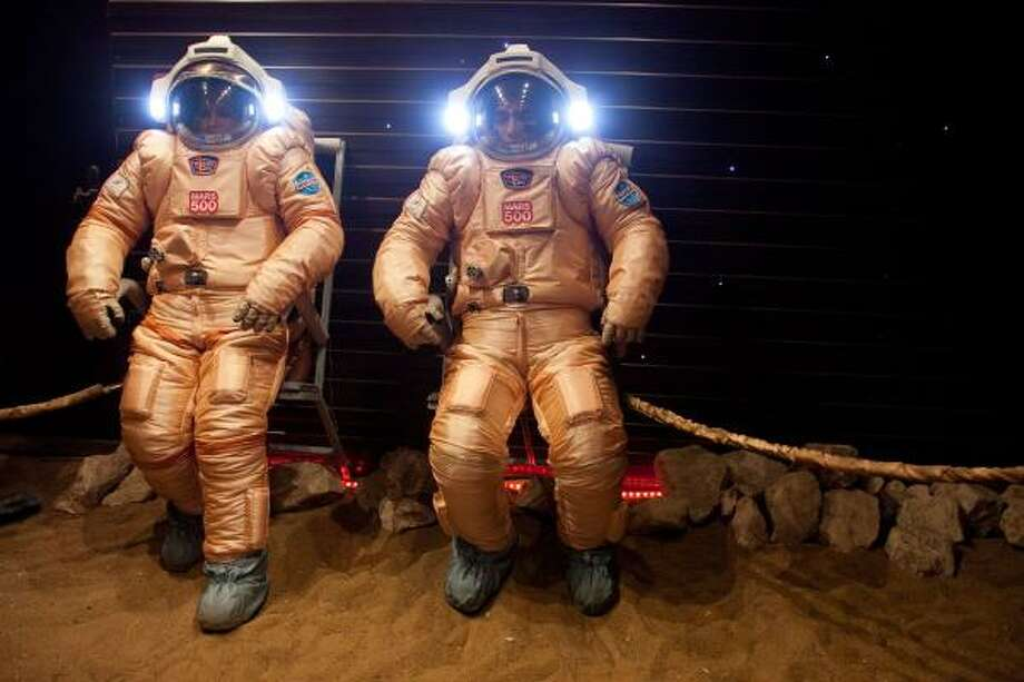 Preflight preparations at Moscow's Institute for Medical and Biological Problems have included tests of spacesuits in a module designed to simulate the Martian surface. Photo: Oleg Voloshin, AP
