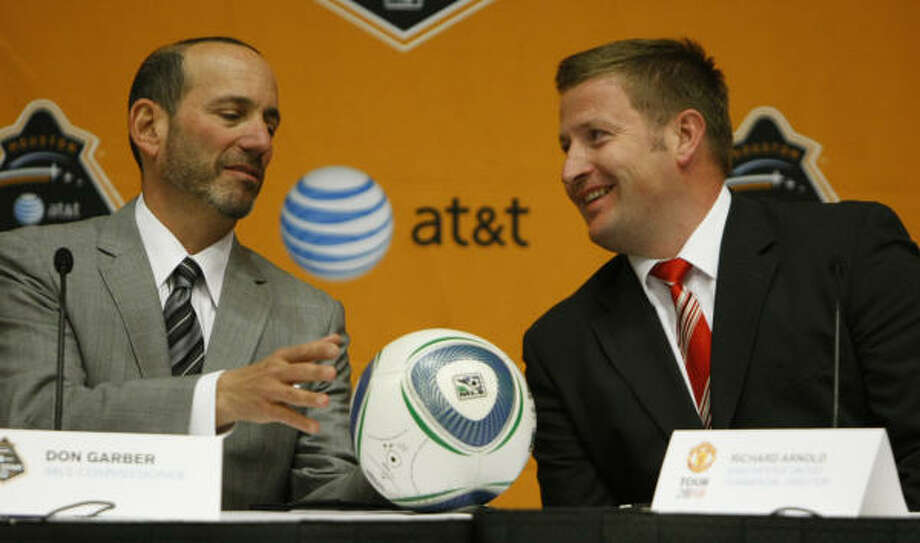 MLS commissioner Don Garber, left, and Manchester United's Richard Arnold anticipate an enthusiastic welcome for the game matching the MLS All-Stars and one of England's storied teams. Photo: Julio Cortez, Chronicle