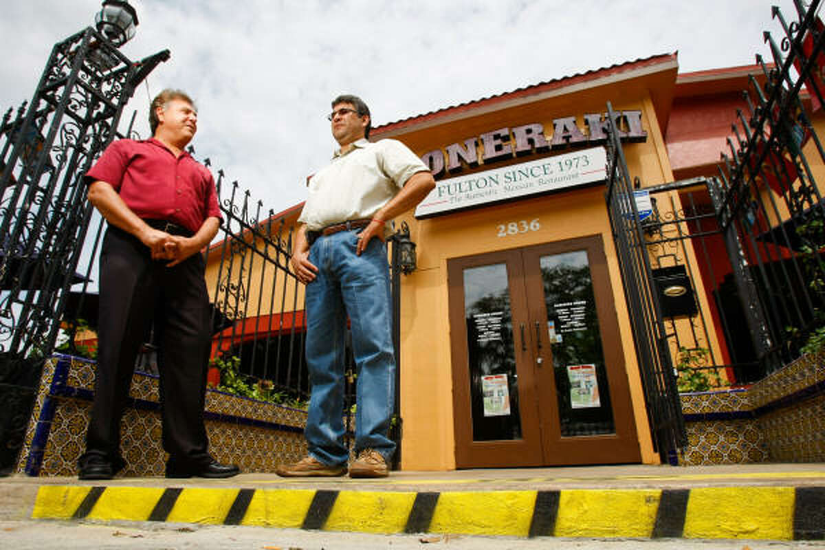 Founder Cesar Rodriguez, left, talks with current Doneraki co-owner Gerardo Padilla outside the restaurant's Fulton location, where it's been serving patrons for nearly 40 years.