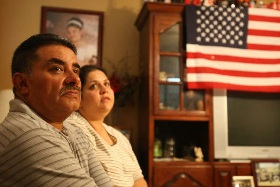 "Jesus Infante and his wife, Nancy, talk about their son, Army Staff Sgt. Jesse Infante, who was killed in Afghanistan on Monday. ""He called me once from over there to let me know he was OK,"" the father said. ""He loved it."" Photo: Julio Cortez, Chronicle"