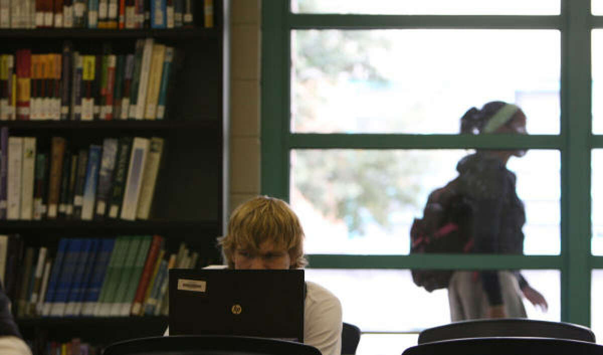 A Lamar student takes advantage of one of the 120 laptop computers the school bought for the library. Under a plan by Superintendent Terry Grier, nearly every HISD student could be getting a laptop for use at home and school.