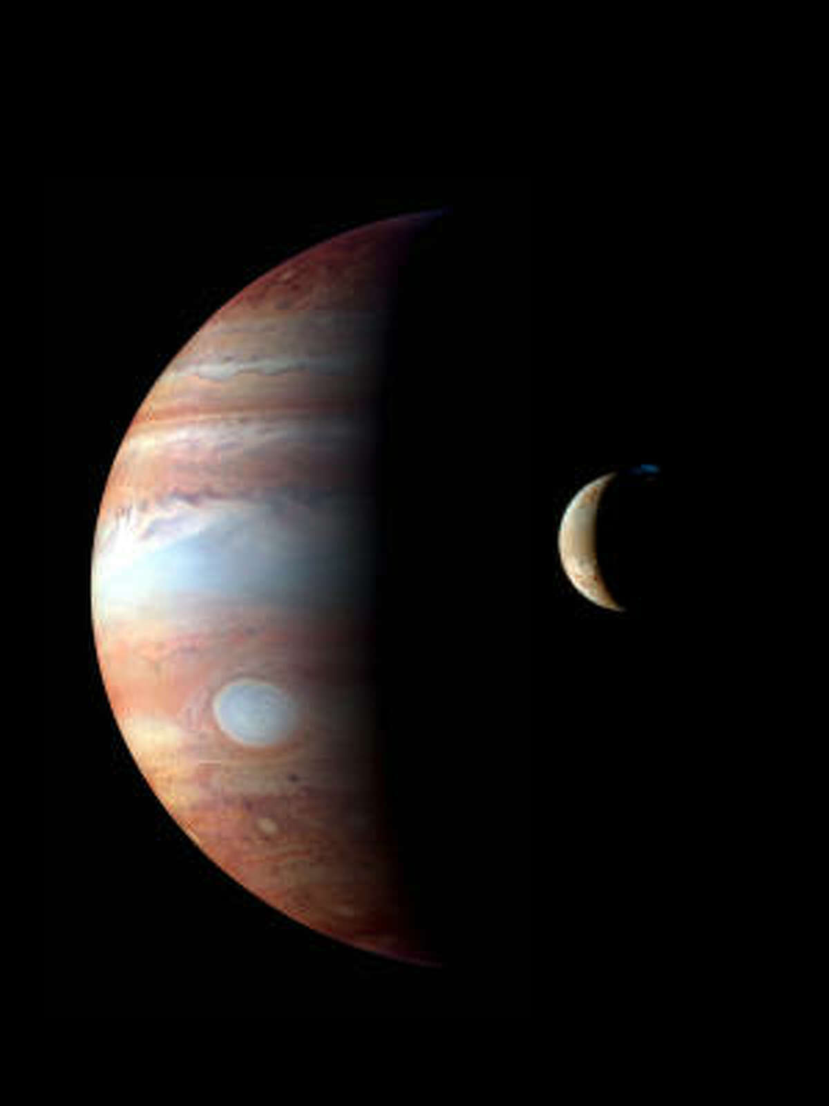 This image of Jupiter and its moon, Io, are part of the Houston Symphony's concert The Planets: An HD Odyssey.