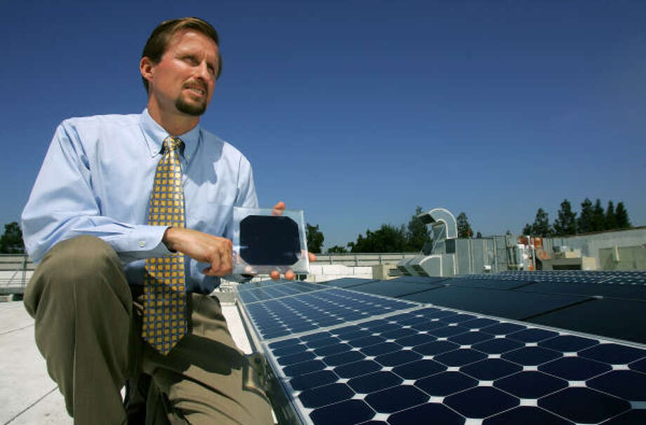 "SunPower Corp. CEO Thomas Werner displays a solar panel on the roof of SunPower building in San Jose, Calif. ""Energy is the biggest opportunity Silicon Valley has ever seen,"" SunPower Chairman T.J. Rodgers says. Photo: JEFF CHIU, Associated Press"