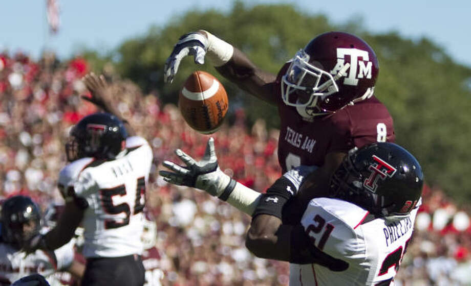 Jeff Fuller draws a pass interference penalty on Texas Tech's Jarvis Phillips during A&M's win on Saturday. Photo: Nick De La Torre, Chronicle