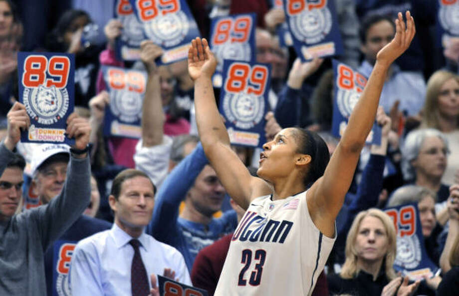 Forward Maya Moore, who has been on hand throughout Connecticut's long winning streak, enjoys the moment after scoring 41 points in a 93-62 victory over Florida State on Tuesday night. Photo: Jessica Hill, AP