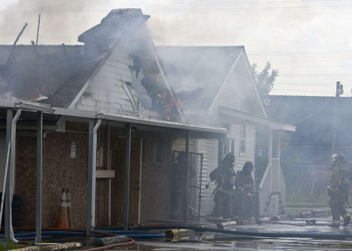 Houston Fire Department crews work in near triple-digit heat to extinguish the fire on Wednesday.