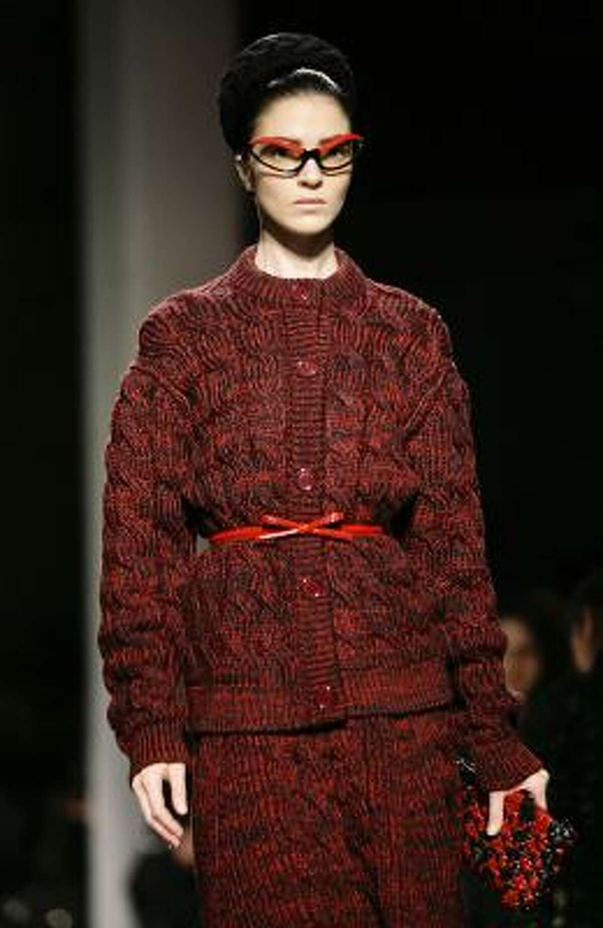Model Mariacarla Boscono goes all out with eyewear during the Prada fall-winter 2010-11 runway show.