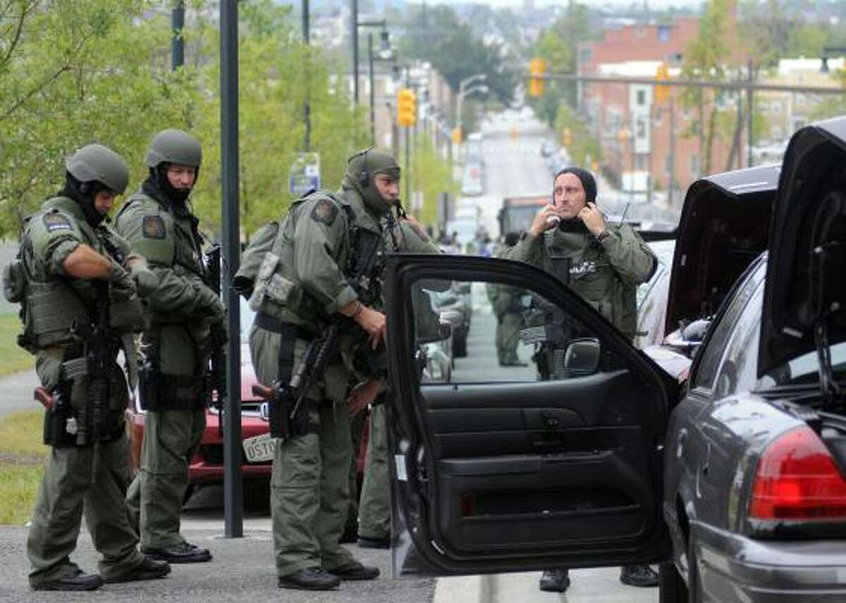 Members of the Baltimore County SWAT team arrive at Johns Hopkins Hospital in Baltimore after a man shot and wounded a doctor on Thursday.