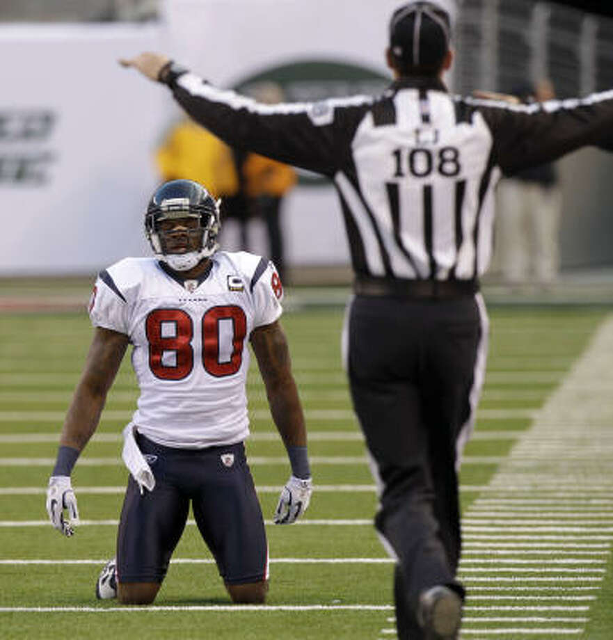 Andre Johnson (80) feels the heat as the Texans hope to steer the ship in a winning direction. Photo: Seth Wenig, AP