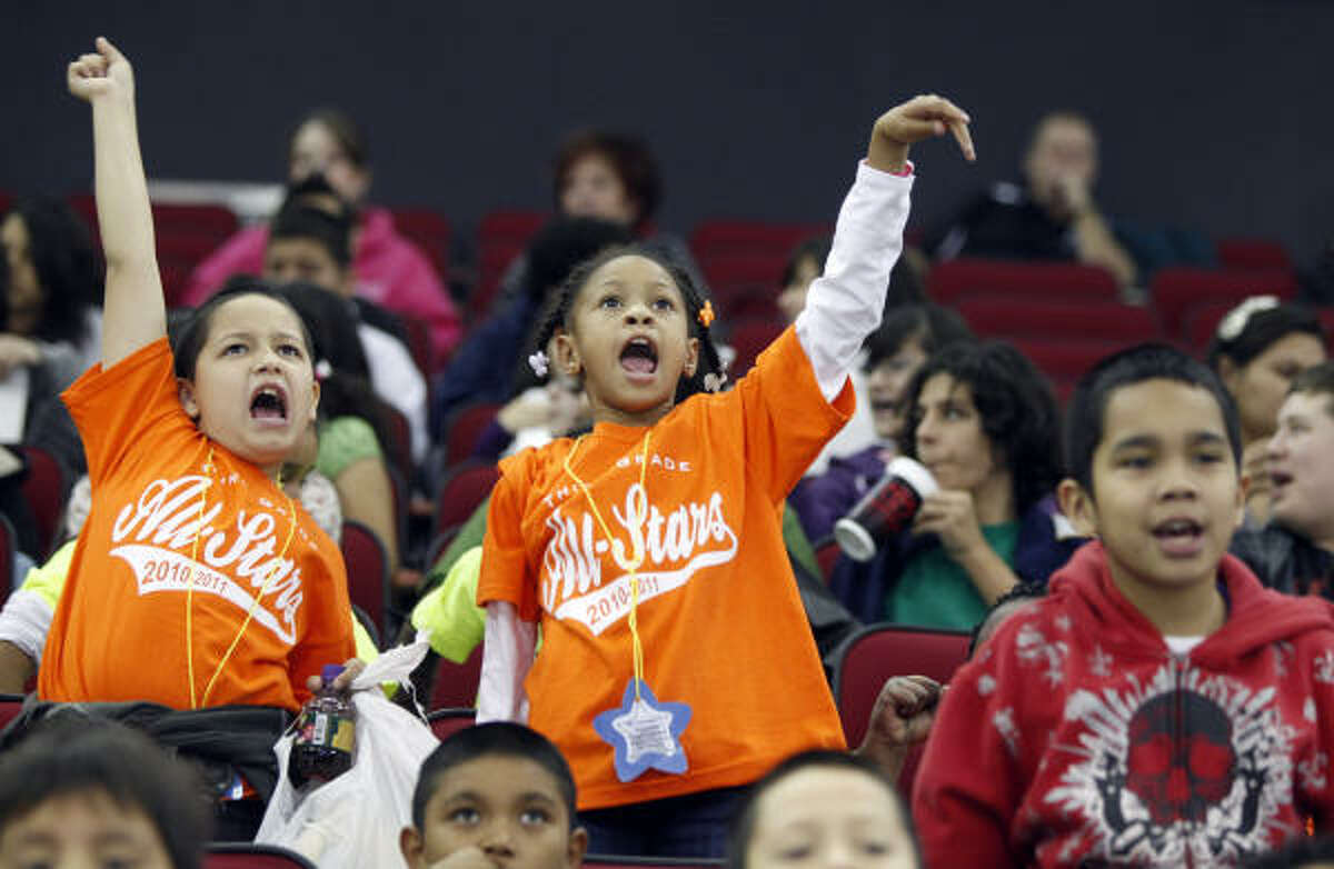 Michael Kertianis, 8, left, and Taija Copeland, 8, center, both third graders at Stephen Elementary in Aldine ISD cheer during the Aeros game. It was the eighth annual Kids Game by the Aeros.