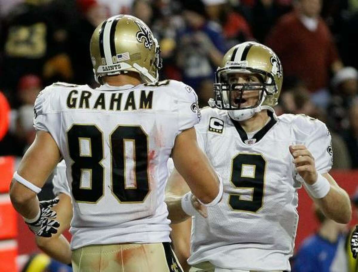 Saints quarterback Drew Brees, right, celebrates a touchdown pass to Jimmy Graham in second half on Monday night.