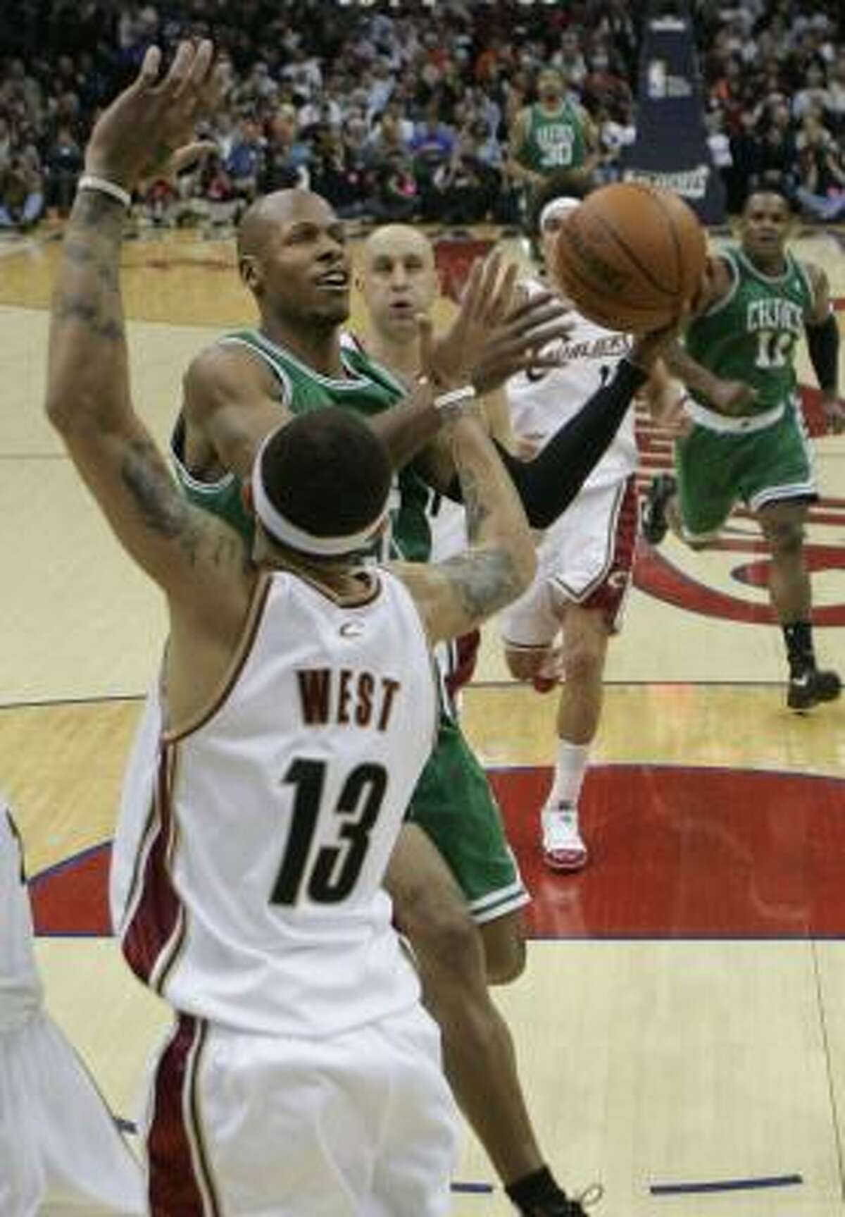 Celtics guard Ray Allen goes up for a shot against Cavaliers guard Delonte West. Allen finished as the game's leading scorer with 25 points.