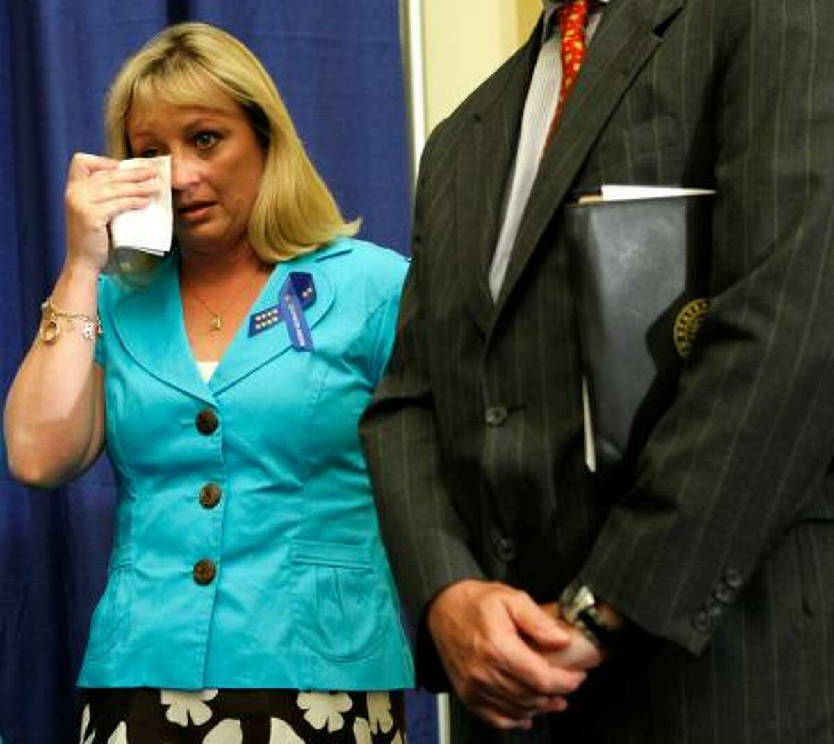 Shelly Anderson, widow of Deepwater Horizon rig worker Jason Anderson, wipes tears during a news conference in Washington, D.C., on Thursday.