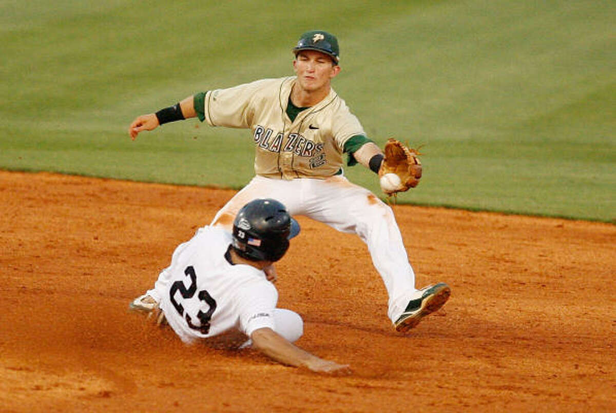 Rice's Anthony Rendon steals second as UAB shortstop Jonathan Merritt mishandles the throw.