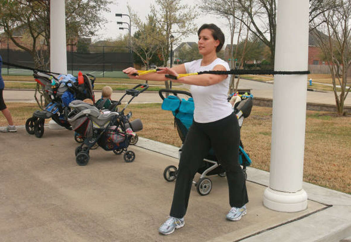 Instructor Maria Gorosito uses a strength tube during a StrollerFit class.