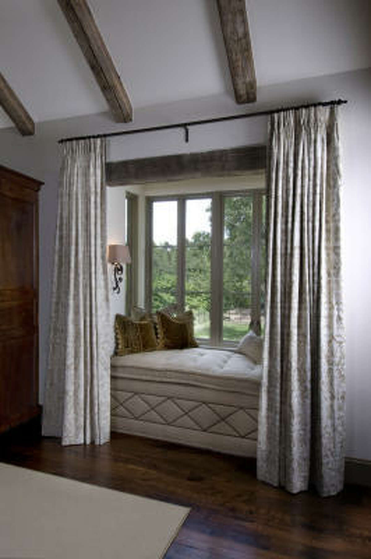 The nook in this master bedroom in Tanglewood is lined with a mattress.