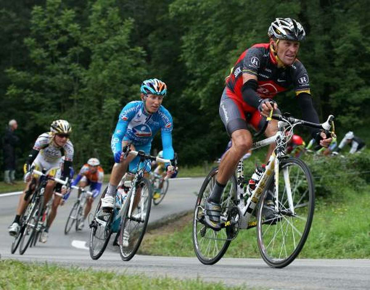 Entering this year's Tour, Lance Armstrong (front) knew he was pushing both his luck and the bounds of probability.
