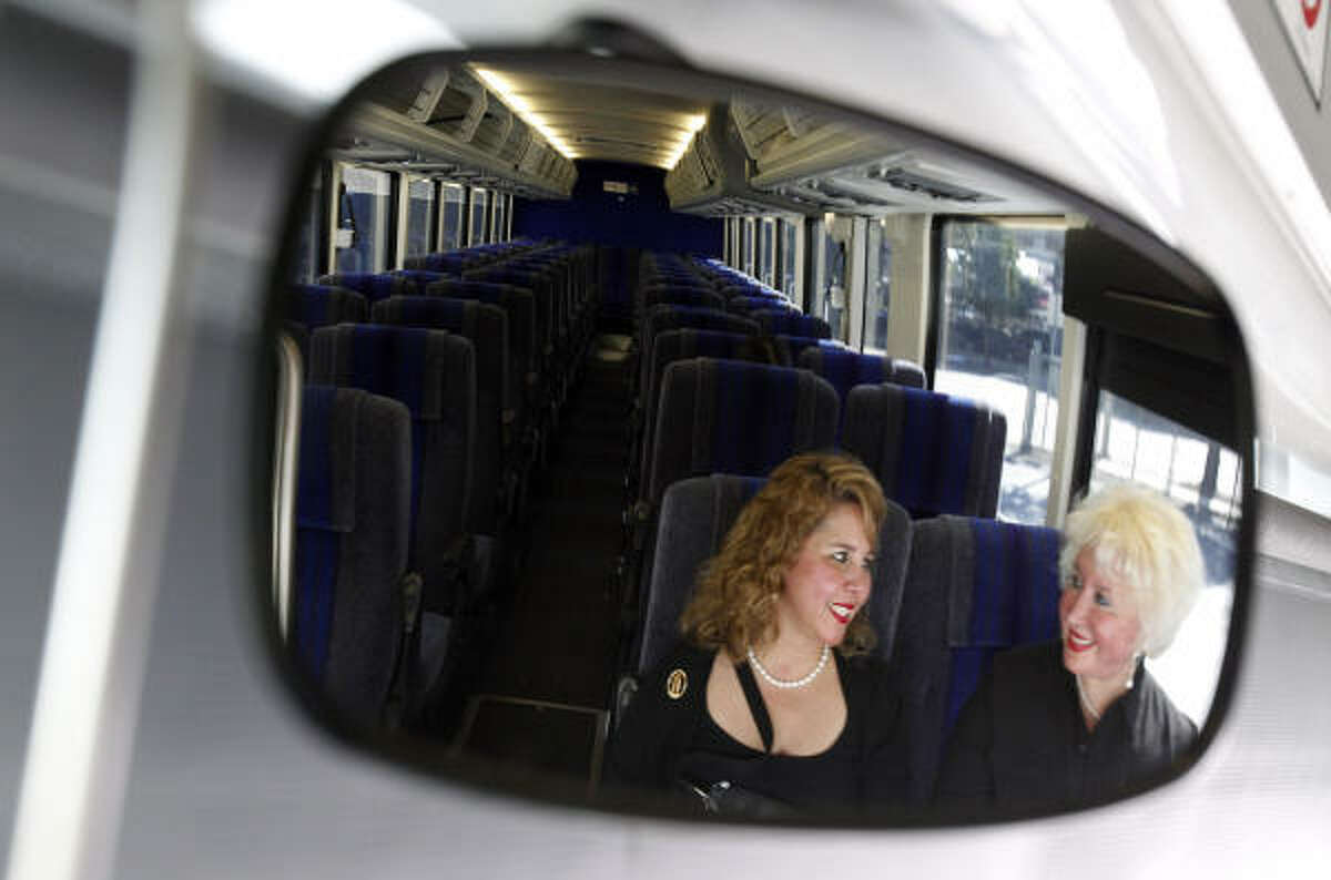 McAllen visitors Leticia Ortega and her mom, Amadita Arredondo, are the only ones reflected in the driver's mirror Thursday on their way to George Bush Intercontinental Airport.