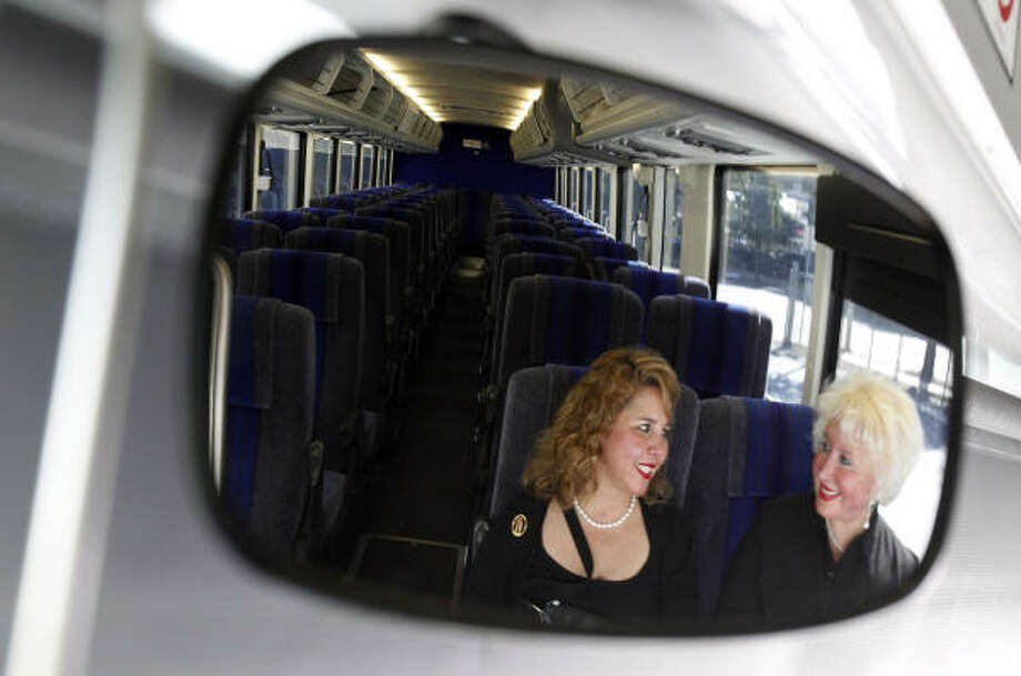 McAllen visitors Leticia Ortega and her mom, Amadita Arredondo, are the only ones reflected in the driver's mirror Thursday on their way to George Bush Intercontinental Airport. Photo: Melissa Phillip, Chronicle