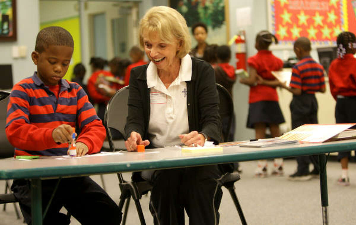 Nancy Chickering, one of a bevy of volunteers at Yellowstone, helps to tutor second-grader Deontay Addison.