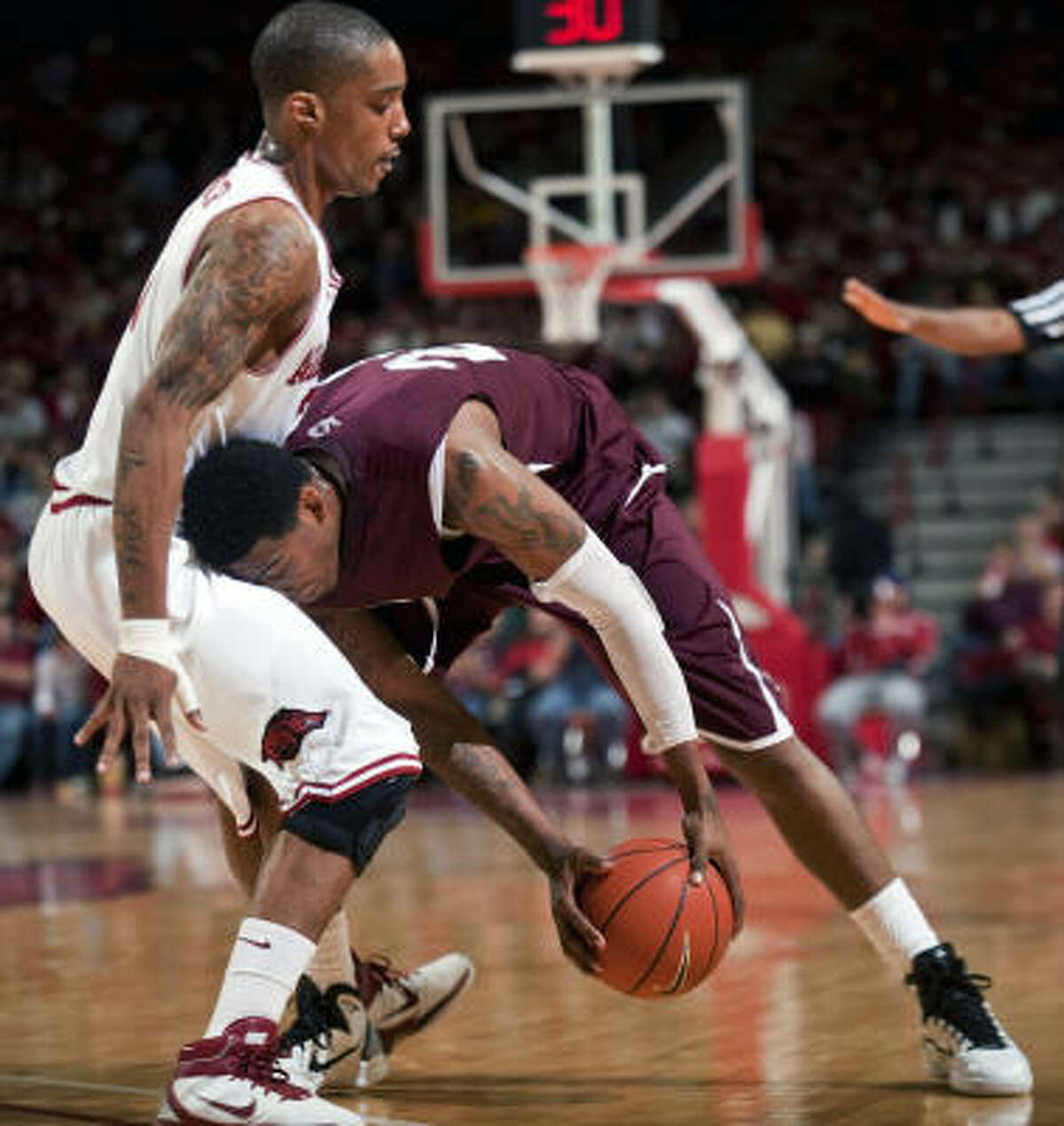 Travele Jones, right, makes a move against Arkansas, one of three games he has played since rejoining TSU.