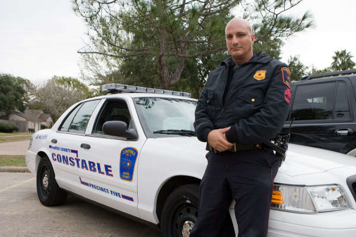 PROTECTING AND SERVING: Precinct 5 Constable?s Office Sgt. Mitchell Hutter is employed by several west Houston neighborhoods to provide additional law enforcement presence in their areas.