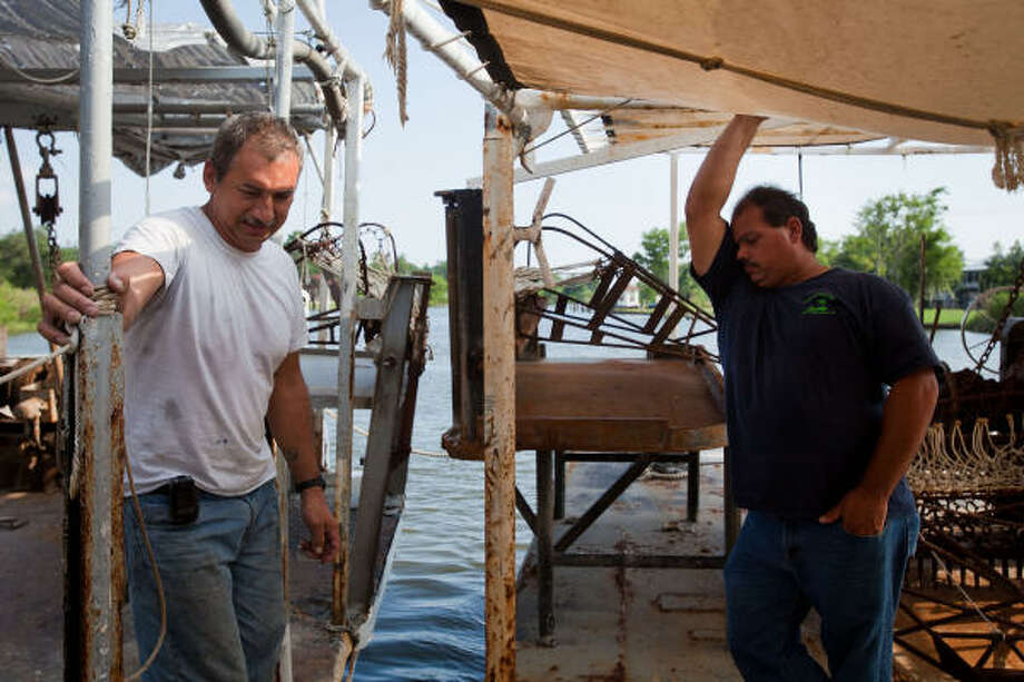 Oysterman Mark Naquin, left, and his cousin Dale Chaisson have seen their business brought to a standstill because of the Deepwater Horizon disaster. Photo: Smiley N. Pool, Chronicle