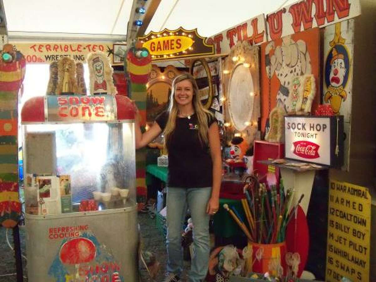 Mandie Murphree's booth at Marburger Farm specializes in circus and carnival items.