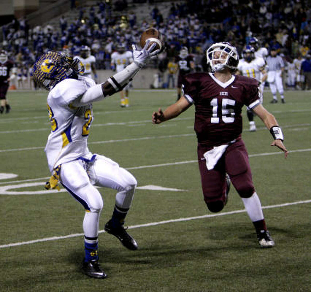 Chapel Hill's Lairamee Lee intercepts a ball intended for Columbia receiver Tyler Ince on Friday night.