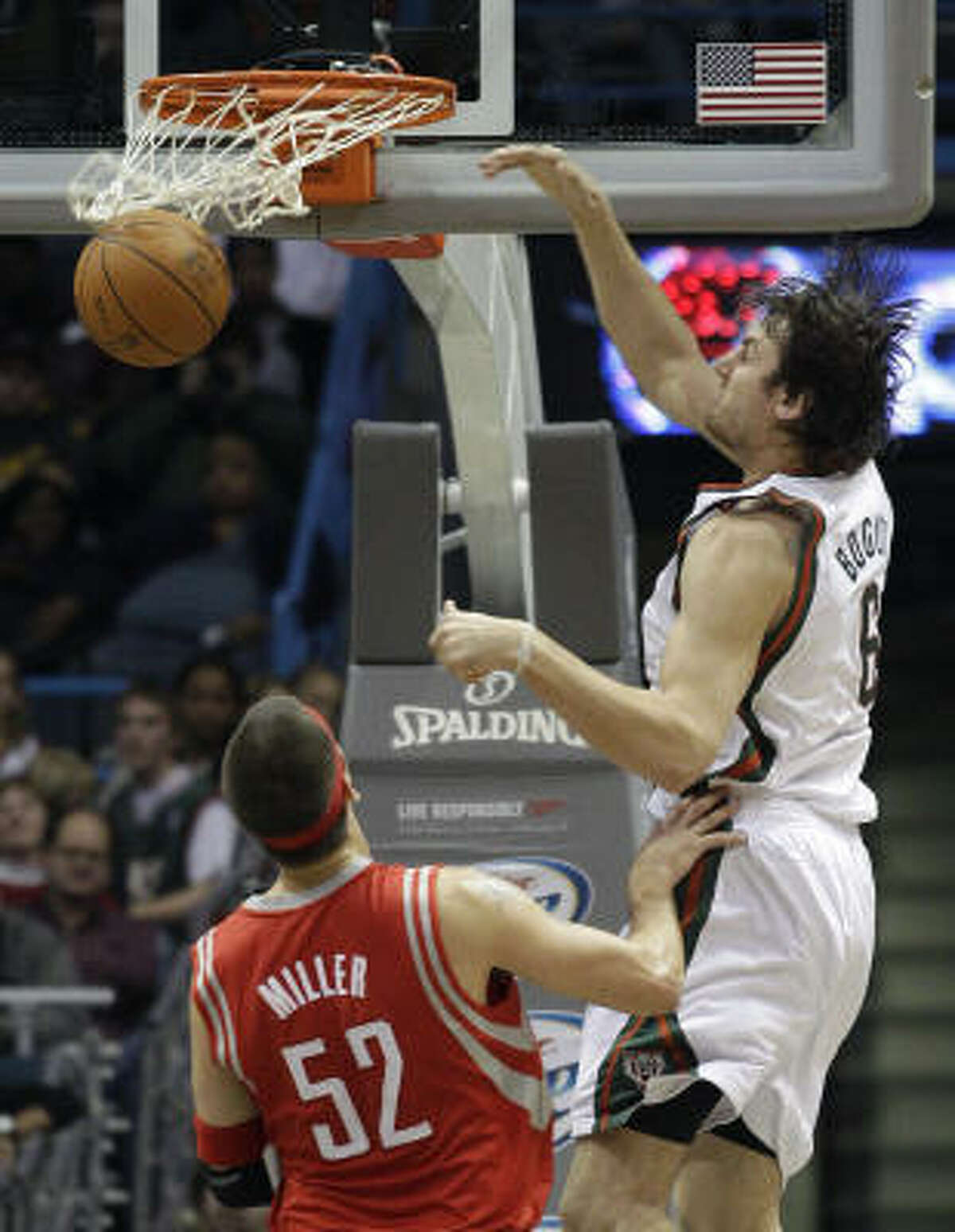 Bucks center Andrew Bogut, right, had 24 points and 22 rebounds in Friday night's victory over Brad Miller and the Rockets.