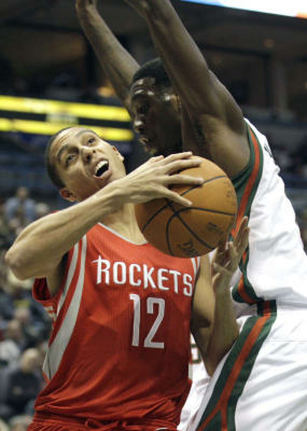 Rockets guard Kevin Martin is fouled by Bucks forward Larry Sanders as he drives to the basket on Friday night.