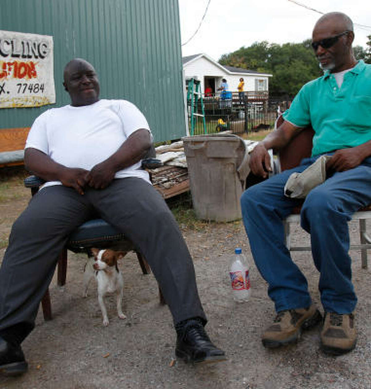 Sid Johnson, left, visits with Kenneth Watson outside Johnson's business Thursday in Waller. Johnson is proud of helping clean up county government.