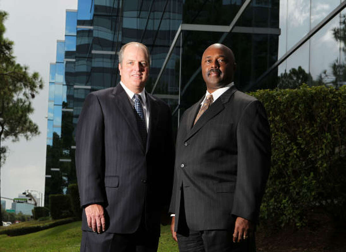 Craig Kaiser, left, and Greg Phillips say their firm has no senior or junior partners, which helps preserve its culture as one of teamwork.