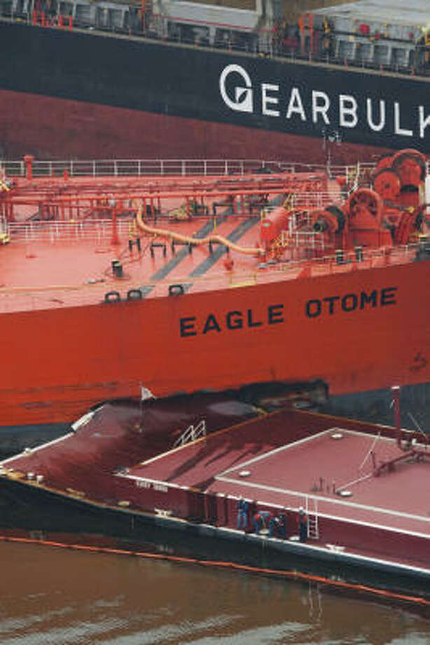 The crash leaves a gash on the Eagle Otome, a 600-foot tank ship. Photo: Julio Cortez, Chronicle