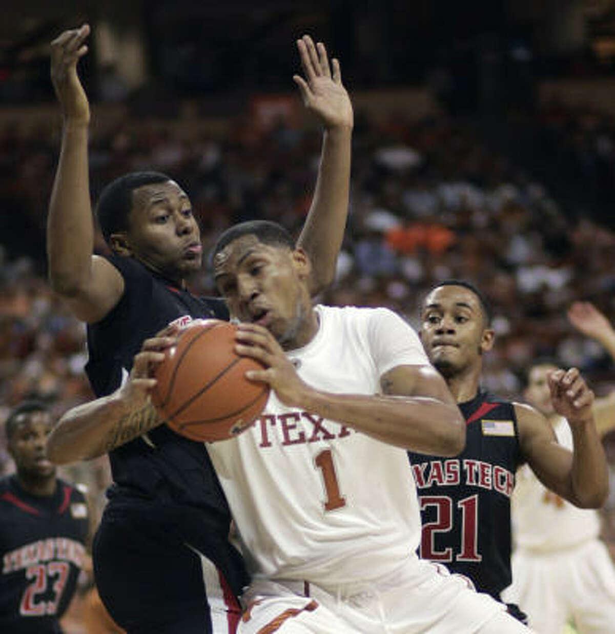 Texas forward Gary Johnson attempts to move around Texas Tech forward Theron Jenkins.
