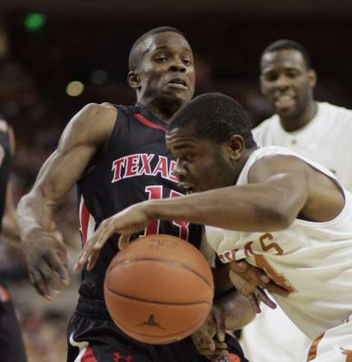 Texas guard Justin Mason tries to drive past Texas Tech guard David Tairu.