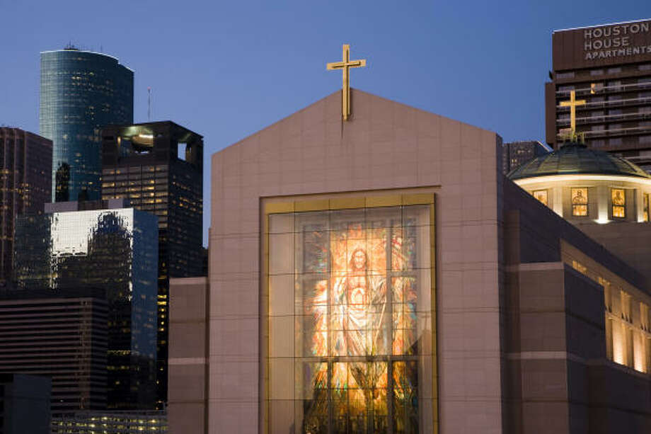 Houston's Co-Cathedral of the Sacred Heart is illuminated at dusk. According to the Yearbook of American and Canadian Churches, the number of North Americans who call themselves Catholic has increased. Photo: SMILEY N. POOL :, CHRONICLE FILE