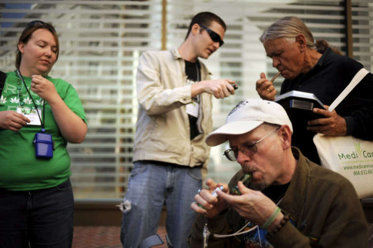 In this Friday Sept. 25, 2009 file photo, attendees at the National Organization for the Reform of Marijuana Laws (NORML) conference, smoke marijuana in San Francisco.
