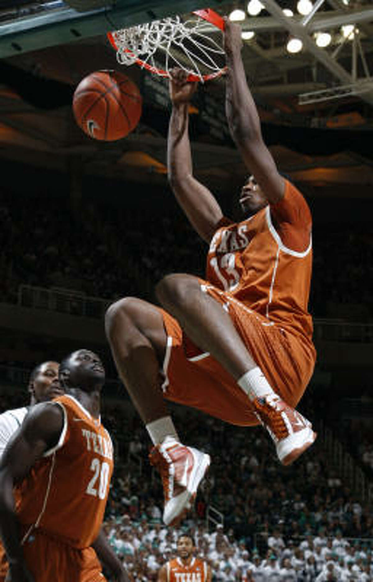 Texas' Tristan Thompson dunks over teammate Alexis Wangmene and Michigan State's Derrick Nix.