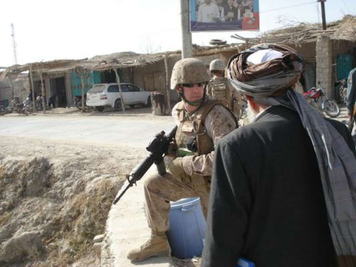 Marine Corps captain John Pooler serves in Afghanistan's Helmand province and expects to return home next year.